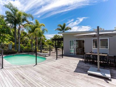 Photo for Spacious, modern and sunny in the heart of Mangawhai, plus it has a pool!
