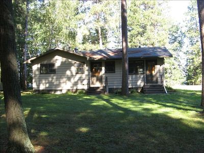 Lake home is situated on a private, deep wooded lot with lots of room to park your vehicle and boat trailer