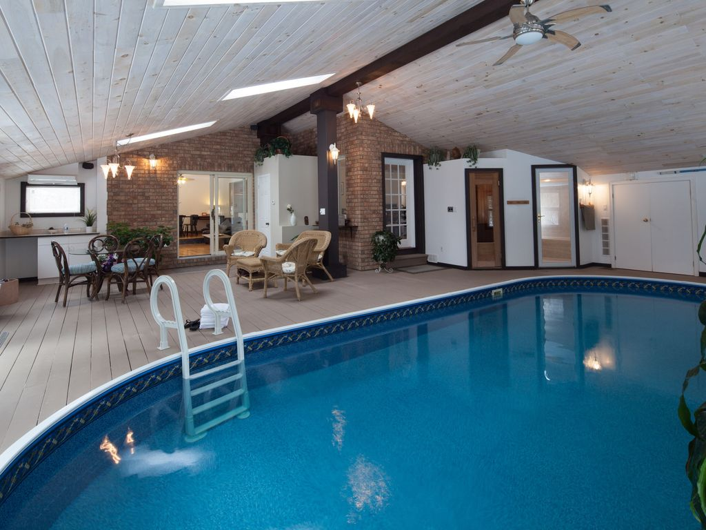 pool room with heated indoor pool sauna and steam room