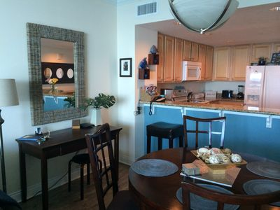 Fully equipped kitchen with more cooking tools, view of desk and dining area
