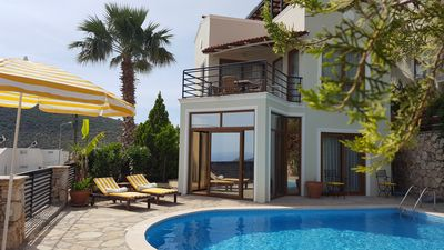 Villa poolside, private garden area at the front.