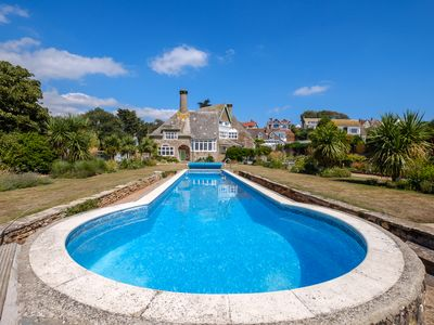 Photo for Wonderful Beachside house sleeps 20 with Watersports,hot tub and swimming pool