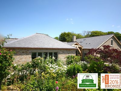 Photo for Award winning Cottage by the sea Tennis/SKY TV/Dogs/Jacuzzi 400m to beach