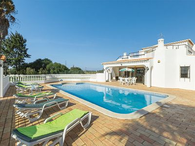 Photo for Relaxing villa w/ pool, lawns + private tennis court, short drive from beach