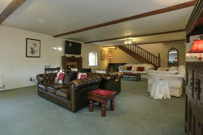 40 foot sitting room with 4, three seater sofas.