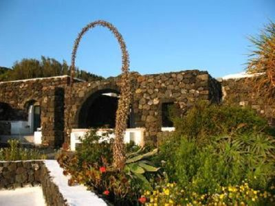 Photo for Antico Dammuso, (typical Pantelleria house) with splendid sea view.