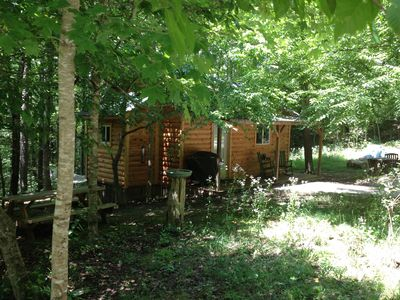 Looking at cabin yard from left, picnic table, grill, hammock, firepit