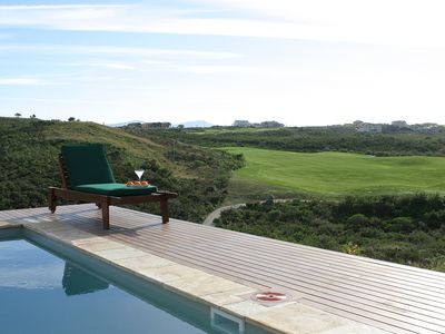 Photo for Stylish clifftop home on secure golf estate. Only 5 mins from Knysna town.