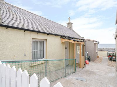 Photo for SEATOWN COTTAGE, romantic, with open fire in Rosehearty, Ref 1010309