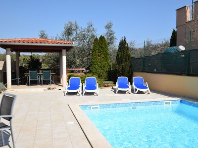 Photo for Comfortable apartment in a quiet village near the sea with pool and grill area