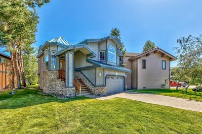 Gorgeous 3BR/2.5BA home in the Tahoe Keys. Great room with open floor plan, kitchen, dining, living, 2 fireplaces, bonus room, hot tub, private boat dock and views for days!