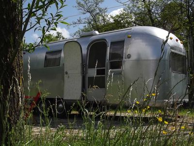 Photo for Retro Airstream caravan in a secluded location directly on Lake Constance, near Konstanz