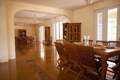 First Floor Living Area has Dining Room and Game Table with Views of the Sea