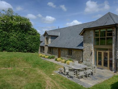 Photo for ROCK BARN, pet friendly, with open fire in South Tawton, Ref 976088