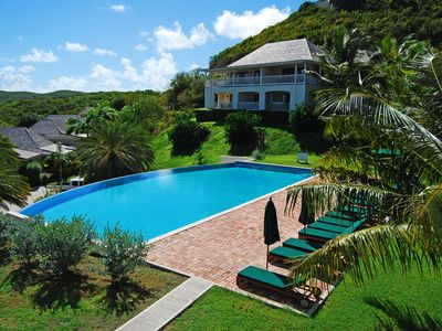 Photo for Nonsuch Bay Resort Private Luxury Apartment by Pool, Superb Bay View, Beach 60m