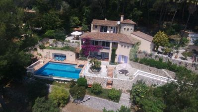 Photo for Spectacular hilltop villa near Cannes overlooking the Cap d'Antibes