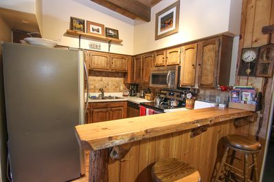 Fully equipped kitchen with newer modern appliances