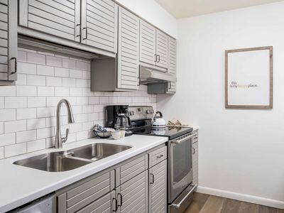 Photo for Gorgeous contemporary condo w/shared pool, hot tubs, sauna & winter shuttle