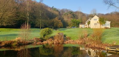View of house across one of the ponds, large garden, woods, 4 fields to explore