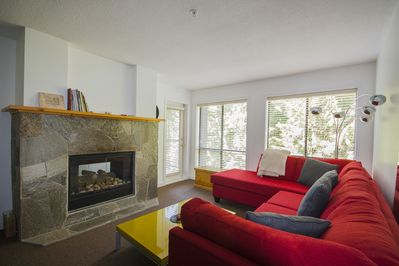 Open plan living room complete with a double sided gas fireplace