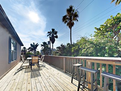 Deck - Enjoy a large private deck at your rental (one-half of a duplex). Professionally managed and maintained by TurnKey Vacation Rentals.