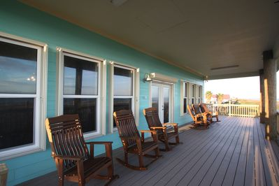 Covered deck with plenty of rocking chairs for relaxing