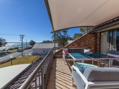 Photo for A Beach Apartment With Panoramic Water Views