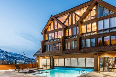 An enormous mountainside penthouse overlooking the pool and slopes