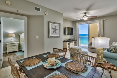 Dining area leads into living room with oceanfront views