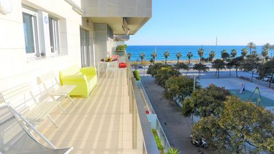 Photo for Sea views, swimming pool, sandy beach, large balcony, garage, wireless internet, air conditioning.