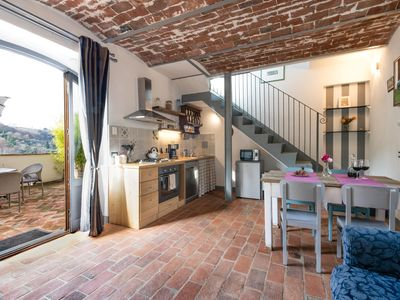 Photo for Apartment with pool and panoramic terrace 2 steps from Florence