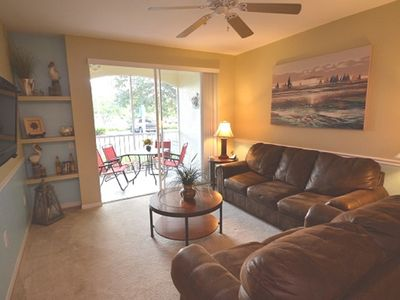 Photo for 3-103 Close to Disney, steps from our heated pool, quiet, gated resort location