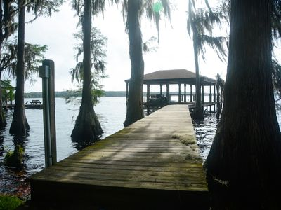 Photo for Secluded lake front home with dock on Lake Louisa only 22 miles from Disney!