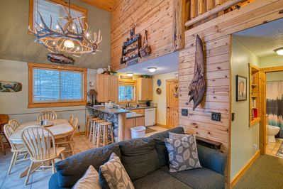 The property has a mountain cabin feel both inside and out. It has a cozy feel but with plenty of room to sleep 20.