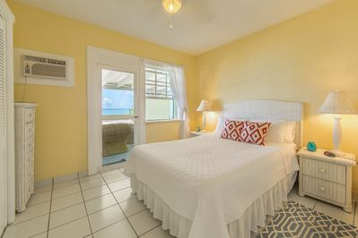 Bedroom with ocean view and access to your units private veranda.
