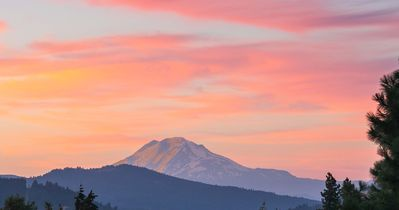 A typical sunset lights up glaciers on Mt. Adams. View from most of the house