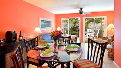 The living area is a vibrant coral, evoking the brilliant colors of the tropics.