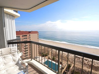 Photo for Bright, comfortable 2 bedroom oceanfront condo with free WiFi, an indoor pool, coastal decor, and an amazing view of the ocean from the balcony located uptown mere steps to the beach!
