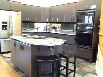 Features Jenn Air Appliances, Granite Countertops, Fully Stocked with Equipment.