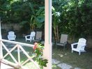 Private back garden off outdoor dining area