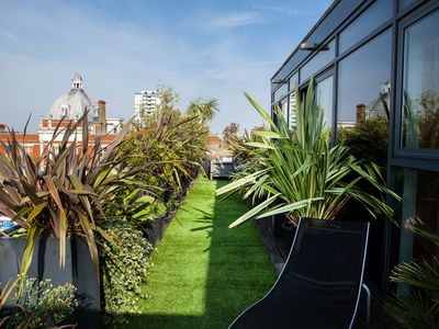 Photo for Stunning luxury penthouse with large wraparound roof terrace