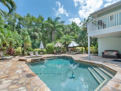 Photo for Whispering Palms:Unique Canal Front, Very Private Tropical Heated Pool & Hot Tub