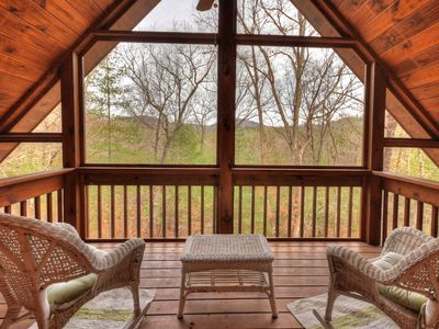 Photo for Enjoy this very cozy cabin rental in the middle of a lush wooded forest, located a few miles from Mineral Bluff, GA. You`ll also enjoy the convenient proximity to McCaysville and Blue Ridge