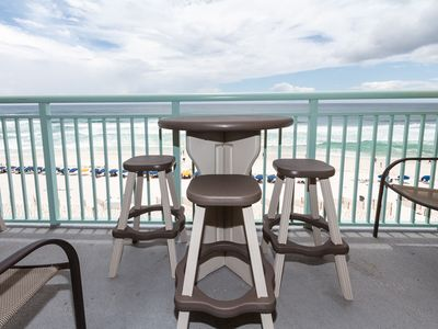 Balcony Furniture - Enjoy a relaxing meal or a cool drink at the bar height table and chairs on the balcony.