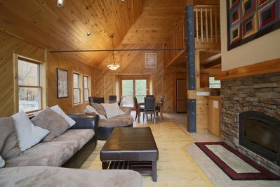 Spacious, yet cozy living area with a wood stove fireplace.