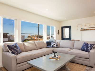 Photo for Beautifully remodeled unit across the street from the beach!