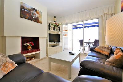 Modern lounge with internet and smart tv. Access to balcony