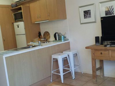 Kitchen with fridge, ceramic cooktop, dishwasher, microwave and utilities