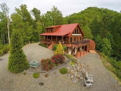 Photo for Secluded log cabin with mountain views, fireplace & wrap-around porch!
