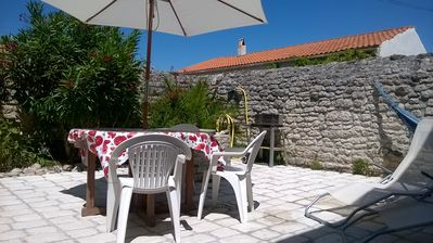 Photo for Typical house, in the center of a small Oleron village, close to the beach.